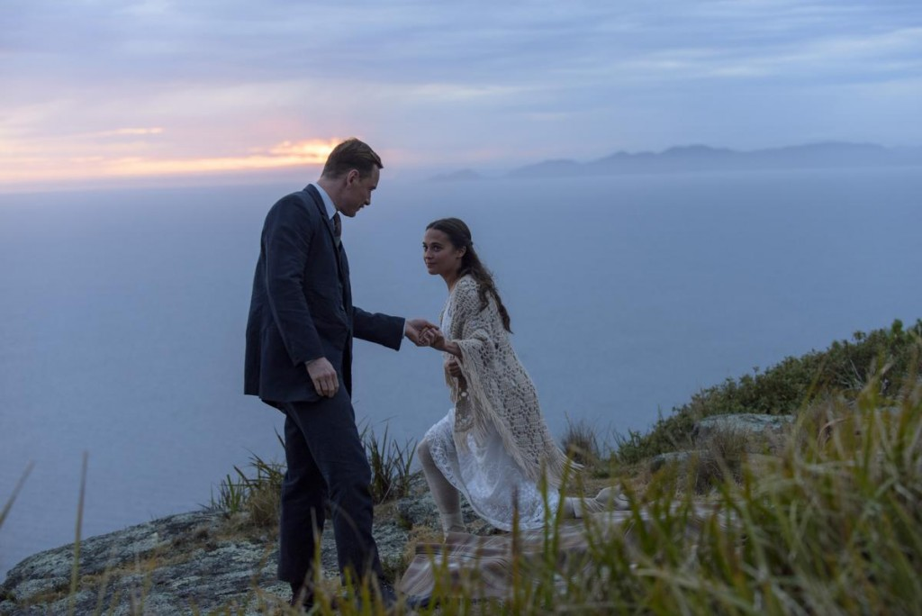 Michael Fassbender stars as Tom Sherbourne and Alicia Vikander as his wife Isabel in DreamWorks Pictures' poignant drama THE LIGHT BETWEEN OCEANS, written and directed by Derek Cianfrance based on the acclaimed novel by M.L. Stedman. Davi Russo ©DreamWorks II Distribution Co., LLC. All Rights Reserved.